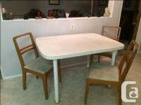 WHITE KITCHEN TABLE AND 6 OAK CHAIRS----1 CAPTAINS
