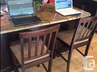 Hardwood table with 4 quality chairs. Perfect for