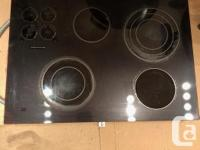 4 burner high-quality smooth-top cooktop. With optional