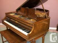 "Knabe grand pianos grand 5'6"" in a walnut Art case."