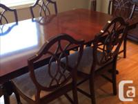 Double pedestal table 62x42 inches plus two one foot