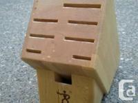 J.A. Henckels 10-Slot Hardwood Blade Storage Block.
