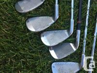 This lot of golf clubs include a Knight pitching wedge,