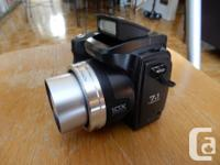 This camera has !)X optical zoom, flash, lens cover,