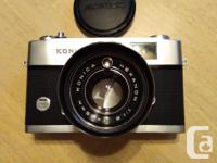 The camera with its lens is in excellent and almost
