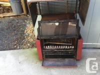 Wood stove with charcoal grill and swing out grill for