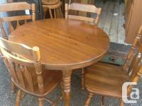 Has 2 leafs, 4 chairs & the table itself. Asking $250..