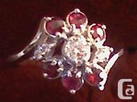 Ladies Diamond and Ruby Ring in 14K White Gold.  Set