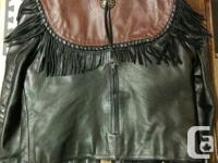 Small size leather jacket and chaps. Good condition.