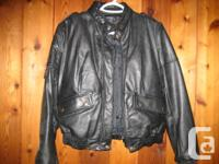 Ladies size 12 black motorcycle jacket. Made in Canada