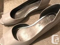 Brand NEW condition Shiny Patent shoes. Very classy.