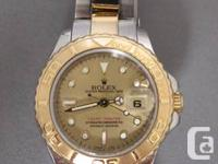 LADIES ROLEX YACHT-MASTER 18K GOLD & S/S WATCH  This is
