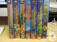 A collection of seven Land Before Time films on vhs.