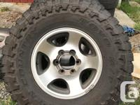 Set of four wheels with Toyo Open Country M/T LT