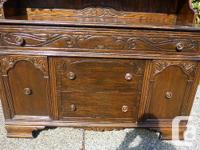 original large. sideboard carved doors and drawer. dark