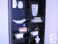 Great black bookcase with some fixed and some