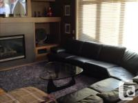 Large black leather sectional for sale. In good shape.