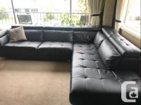 Really nice black sectional sofa. Headrests lay flat or