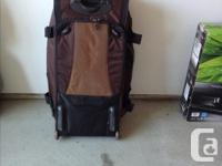 Large bag, numerous pockets, with wheels, can be worn