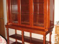 Solid wood cabinet, three glass doors on upper unit,