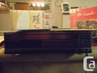 Genexxa Laser disc Karaoke Machine.   This takes up to
