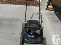 SELF PROPELLED, MULCHING MOWER WITH TOUCH-N-MOW