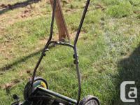 Reel Mower. A clean, precise, scissor - like cut for