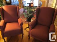 2 attractive wine tinted winged back recliner chairs.