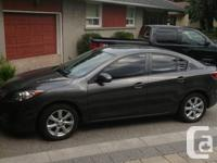 2011 mazda 3 only 23000km .charcoal grey on black