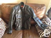 This is a good quality leather riding jacket. Made by