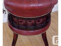 This leather captain's chair was hand-made in England