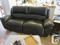 Dark brown leather reclining couch - each side can