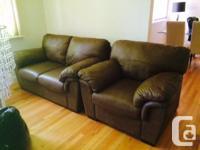 A beautiful leather sofa , loveseat & large matching