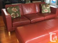 Red leather couch and ottoman in really great shape.