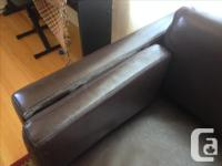 A black Ikea leather couch, about 6 years old. It is a