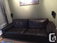 Large high end couch in dark brown. It is 91 inches