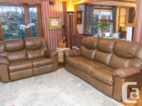 Brown Leather reclining sofa and loveseat. Canadian