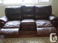 Leather recliner sofa. Three relaxing settings, up