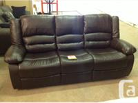Brand new bonded leather reclining sofa and recliner.