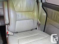 Full set of tan leather seats. Power heated front