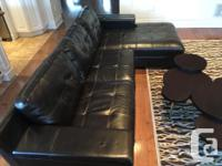 Great used genuine leather sectional with a modern