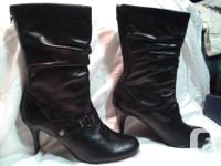Outstanding condition. 3 inch heal, black leather