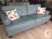 This couch is beautiful! Sea foam color. Not even a