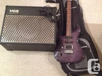A Left Handed Purple Grey Ibanez SA Series electric