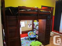 American Spirit twin loft bed with a desk, bookcase is