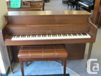 Lesage console piano with bench.  This piano is rated