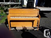 Lesage piano with oak finish that still plays, with