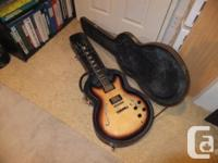 This is a remarkable copy of a Gibson ES-335. The pick