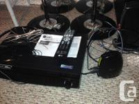 LG DVD player with remote, 4 tower speakers and 1