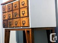 This 100% custom built 12 drawer solid wood cupboard.